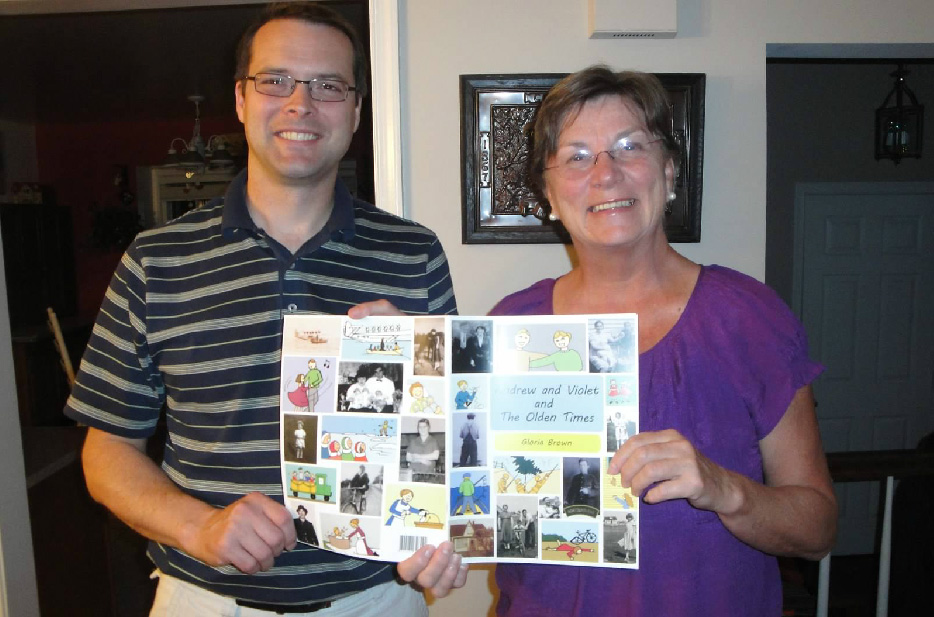 My husband and mom showing the finished family comic book