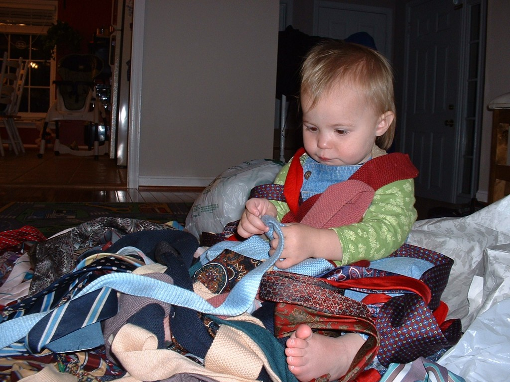 My daughter Nora playing with a pile of men's ties that I got on Freecycle