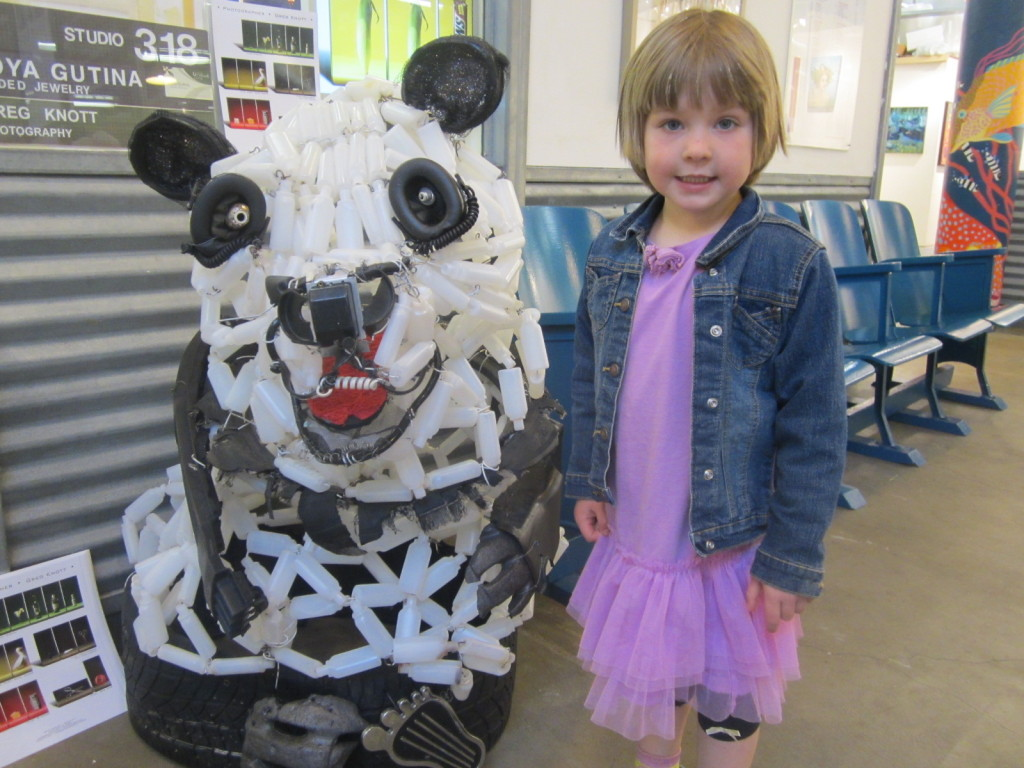 Charlotte with a panda bear sculpture made from recycled materials, I think by Jackie Ehle