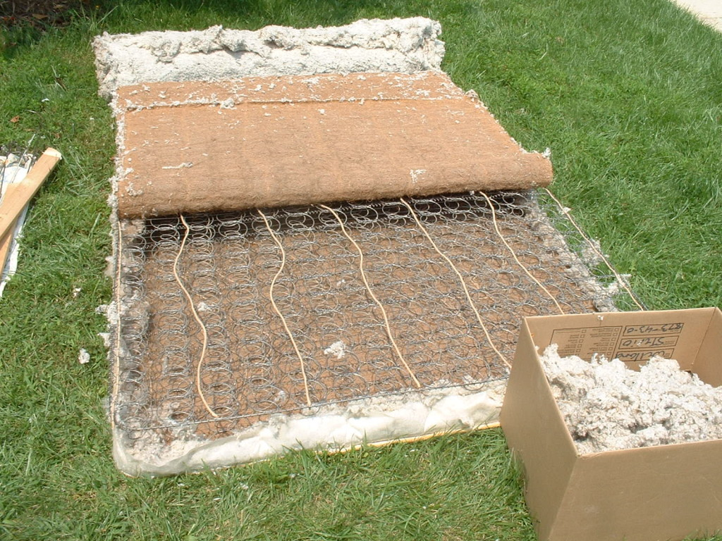 Mattress with the coir layer pulled back - metal springs visible
