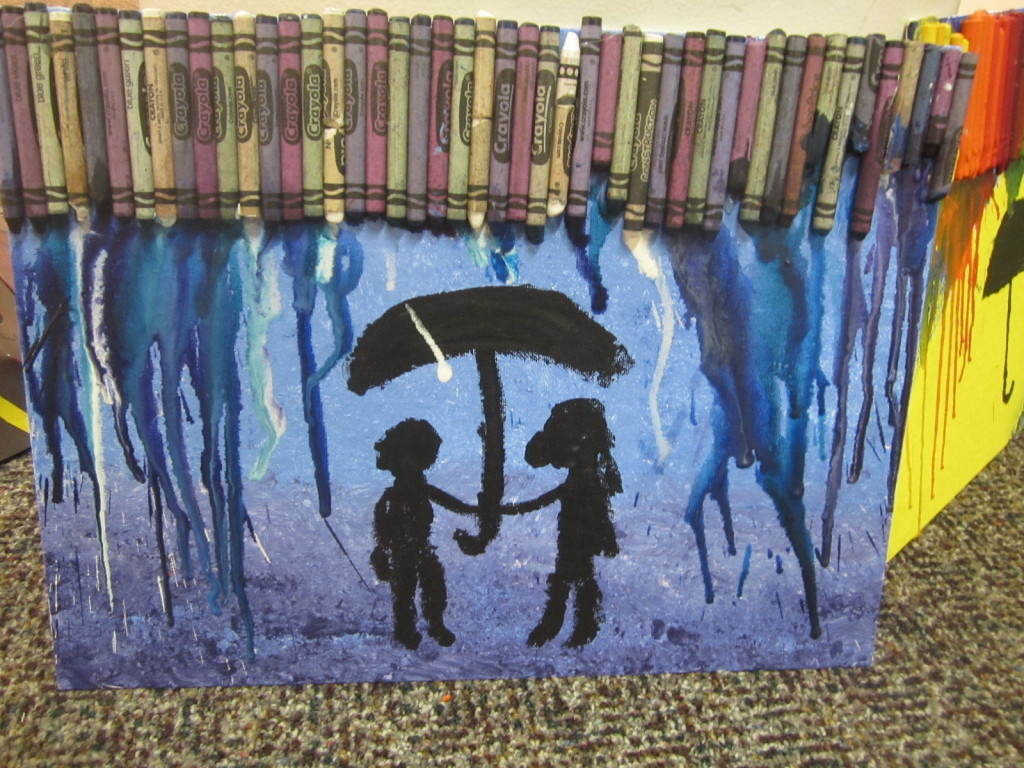Nora's crayon art - umbrella in the rain