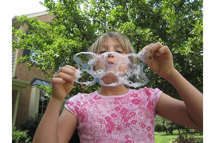 Nora blows bubbles from six-pack ring