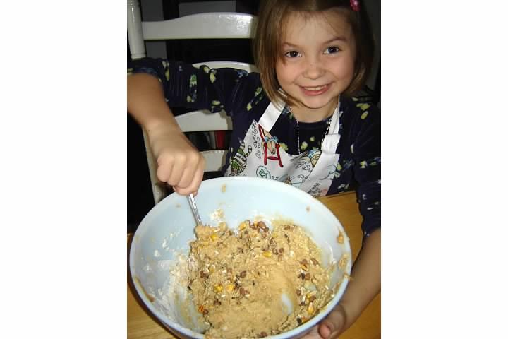 Nora mixes bird food for our egg carton bird feeder, December 2010