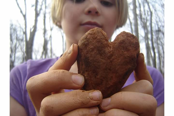 Nora sculpts a heart from clay, November 2011