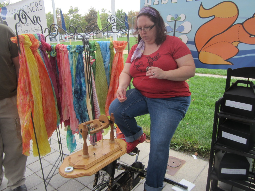 Joy Cain and her bicycle spinning wheel