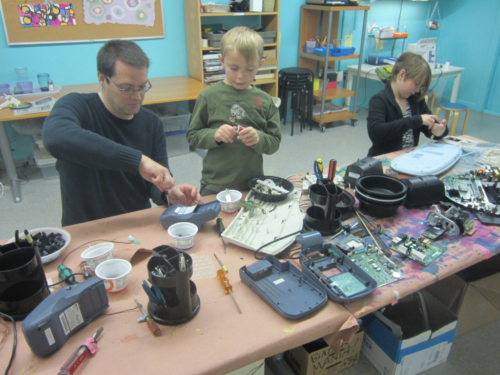 Bob & the kids do Take-Apart activity at Upcycle