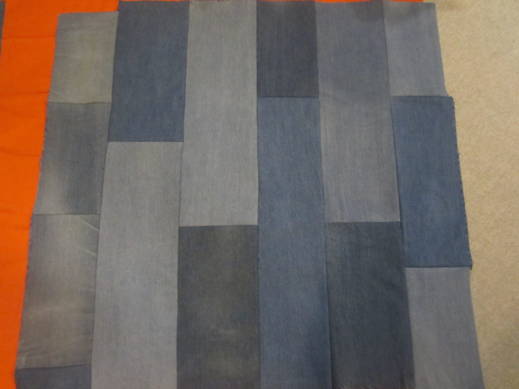 Strips of jeans sewn together for our cushion