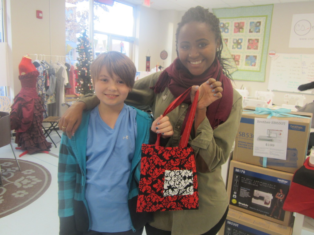 Nora & her teacher Margery at Craft Stitches with the bag she sewed