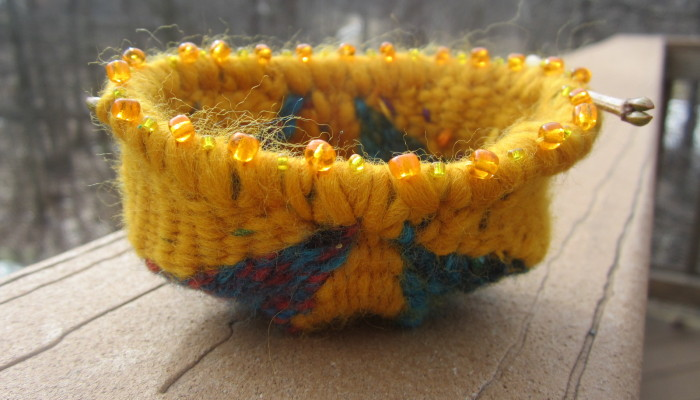 Woven receiving bowl - sun shines through beads