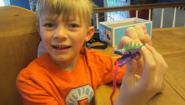 Russell with his clothespin lizard