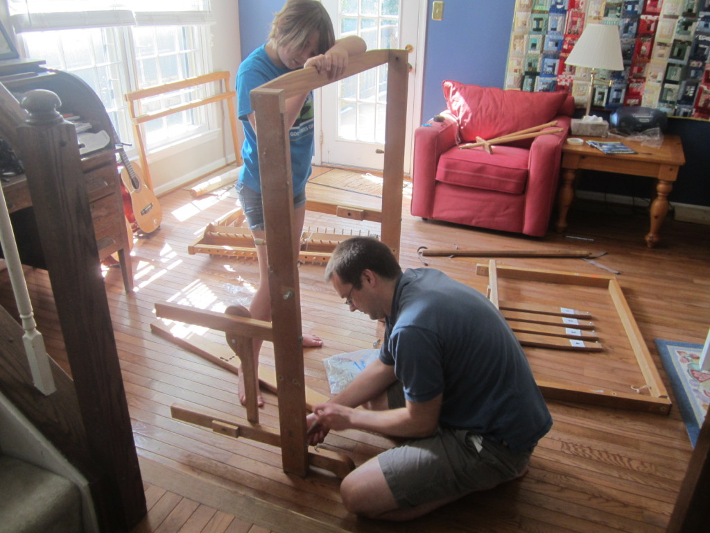 Putting the center beam of the loom together