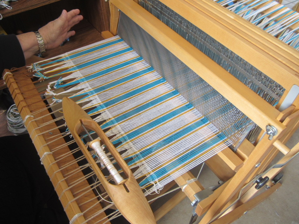 My warp with 6 weft threads to even it out