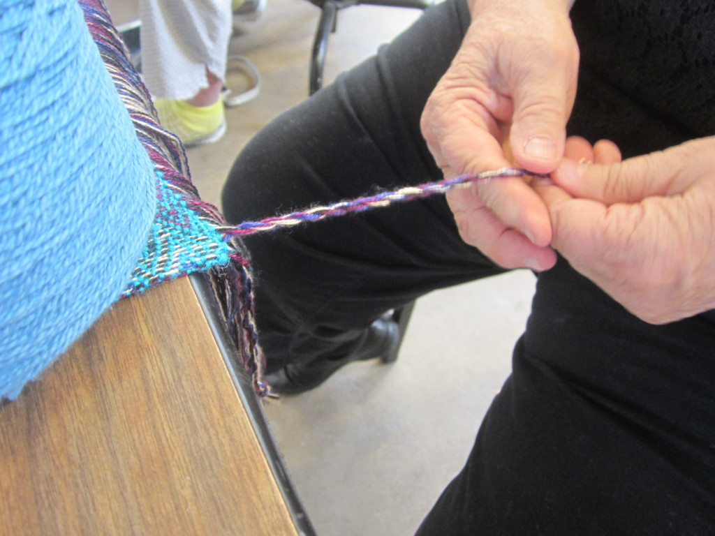 Step 2 of making a fringe - rolling the two bunches together
