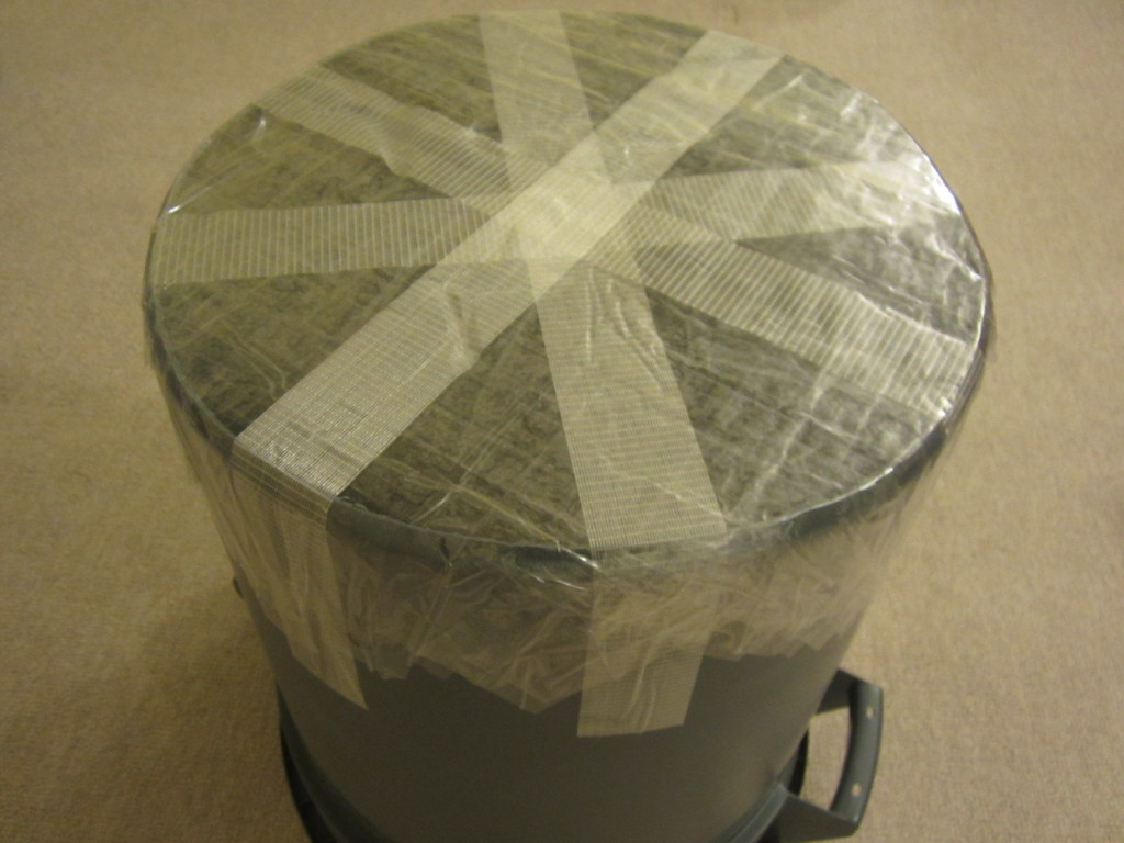 Packing tape forms the head of the garbage can taiko drum