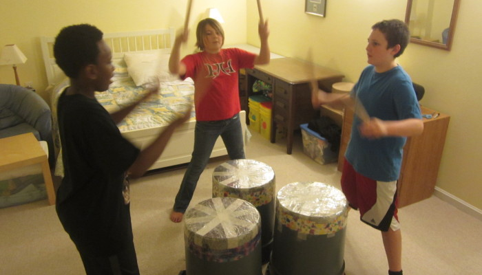 The kids practice their taiko drumming act