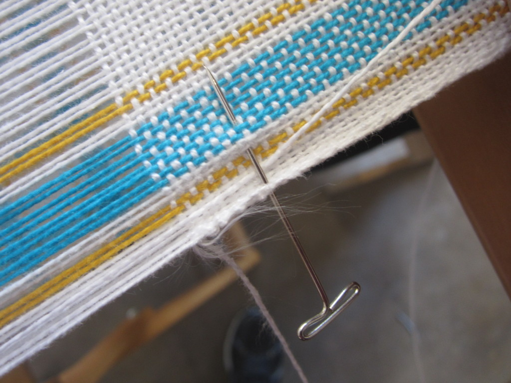 Putting in a pin to anchor a new warp thread