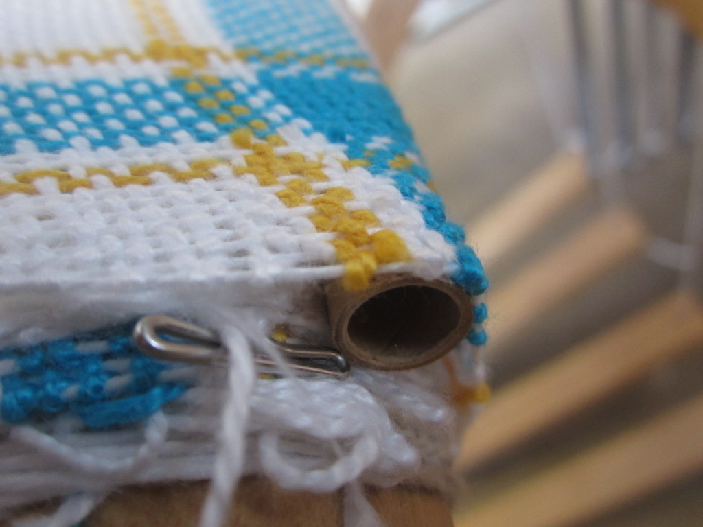 A tube shoved in the cloth roller to add tension