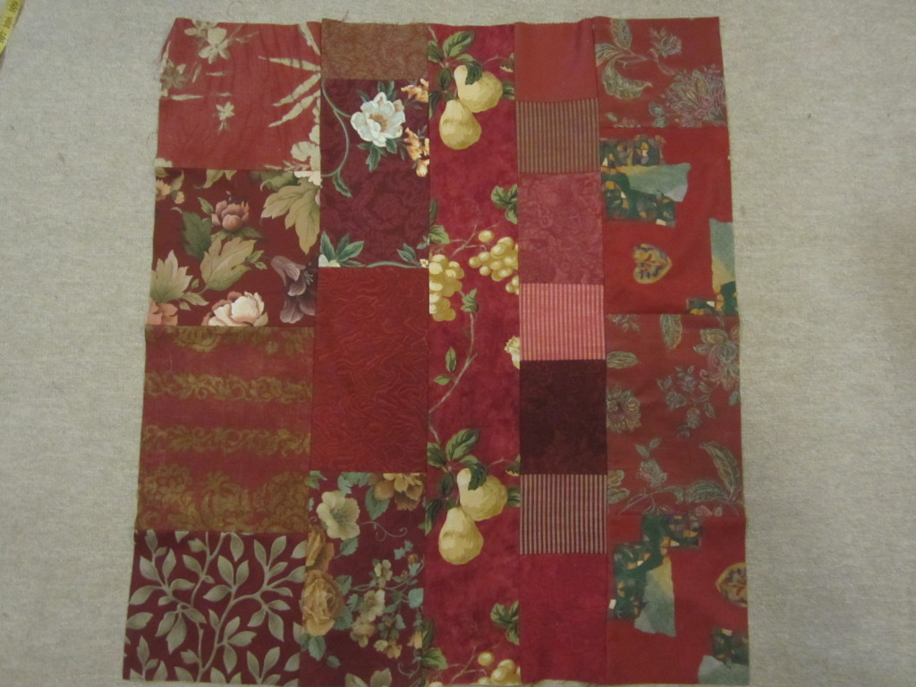 The pieced burgundy quilt for the bolster cover