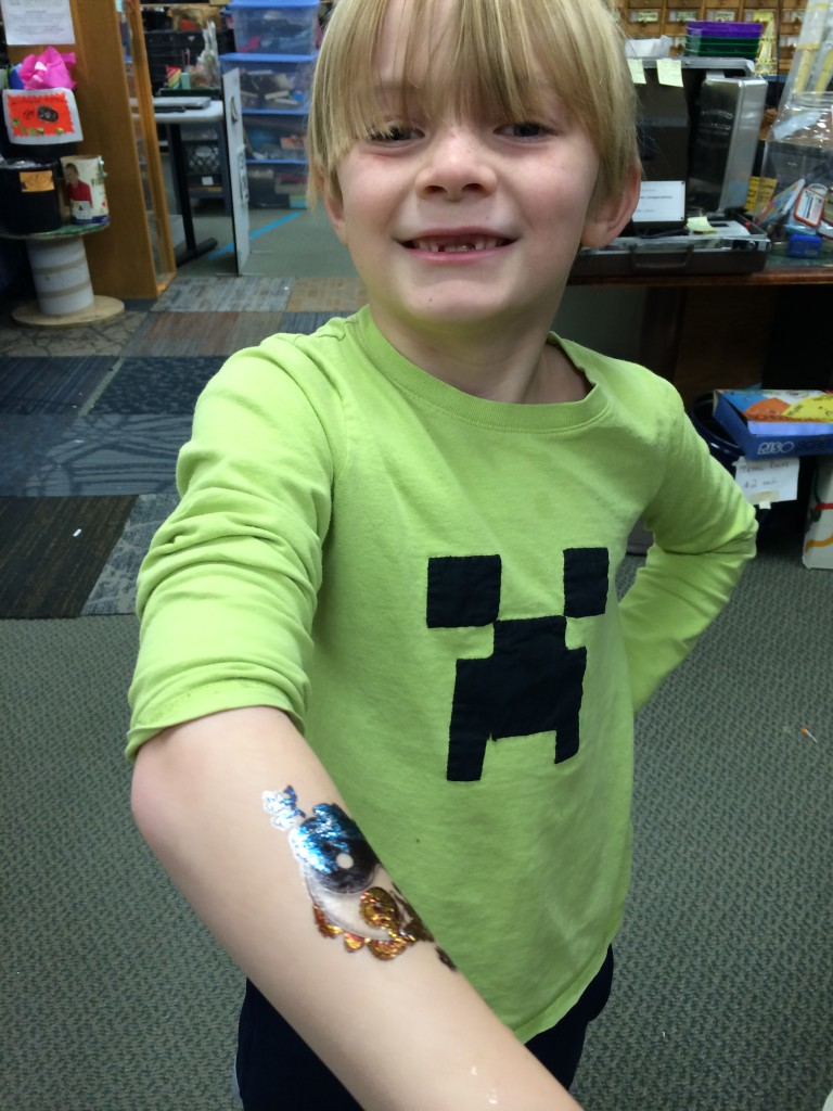 Very proud of his temporary tattoo at the Pittsburgh Center for Creative Reuse