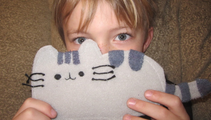 My son with his handmade Pusheen toy