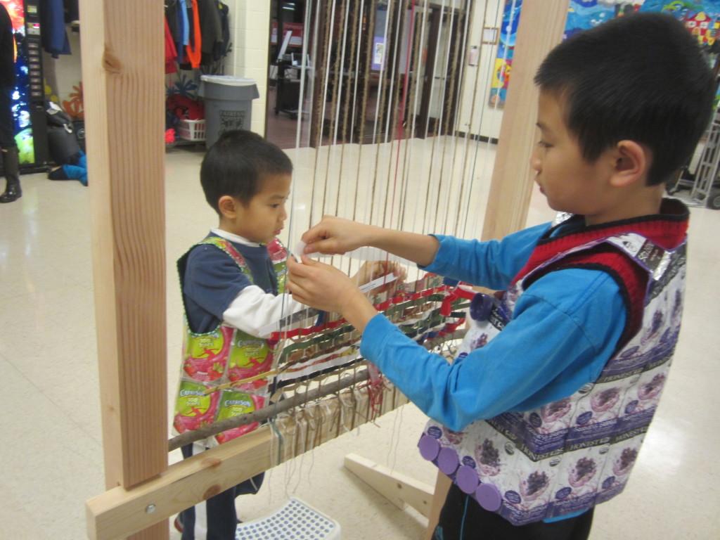 Boys weave on Story Loom