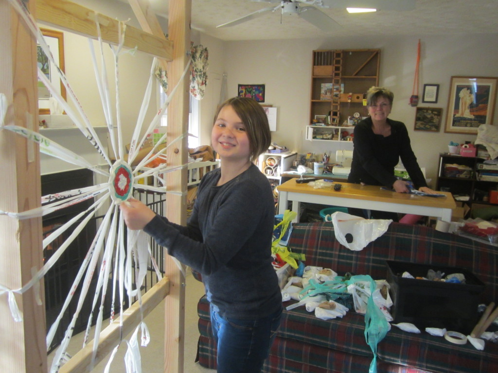 Mom makes loops to weave, Nora weaves them into the spiral
