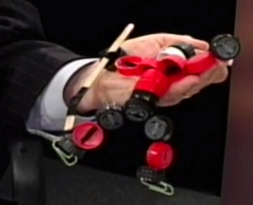 Delegate Ken Plum shows a hockey player craft made from plastic caps