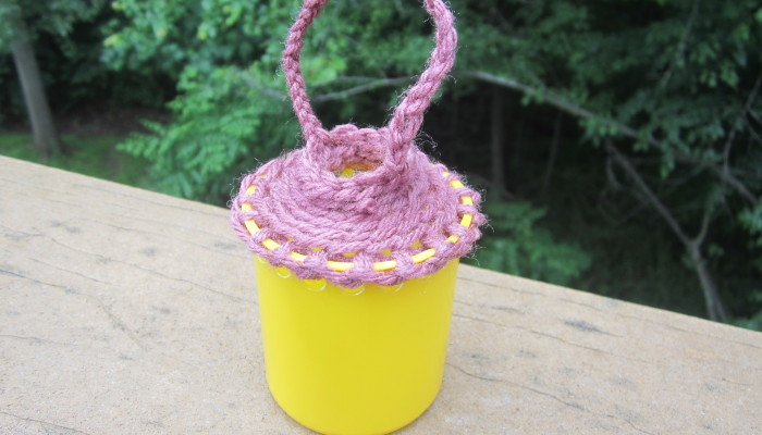 Crocheted basket from plastic container