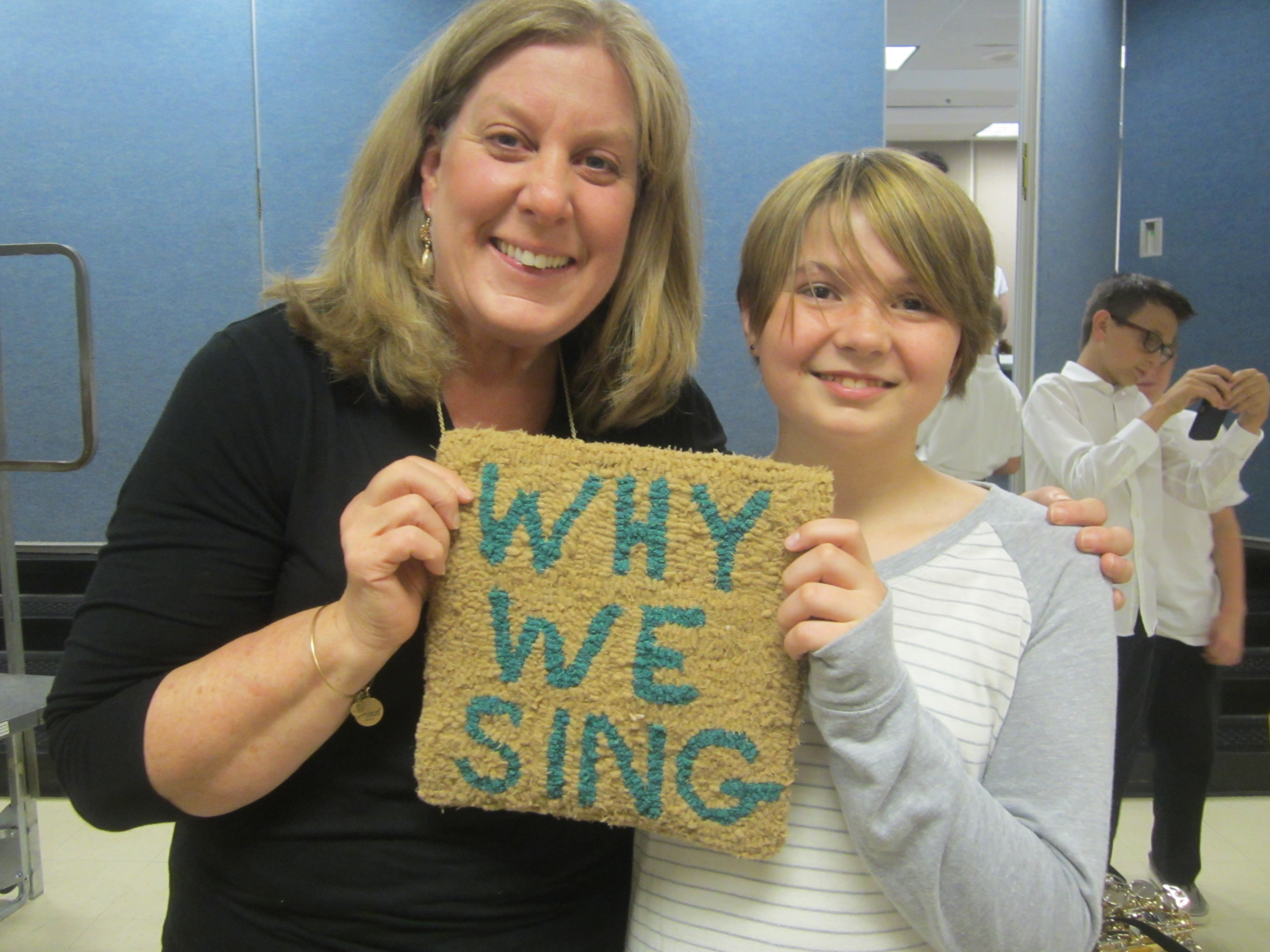 Giving Ms. Anderson the Why We Sing Rug at Year-End Concert