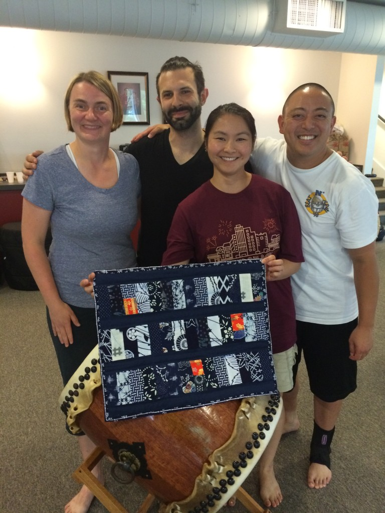 "Giving Lisa a quilt named ""Three Apprentices"" to thank her for leading the teaching program this year"