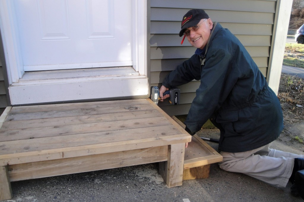 My dad building a step for my sister's house with scrap wood