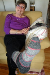 Mom showing off her socks with yarn leftovers