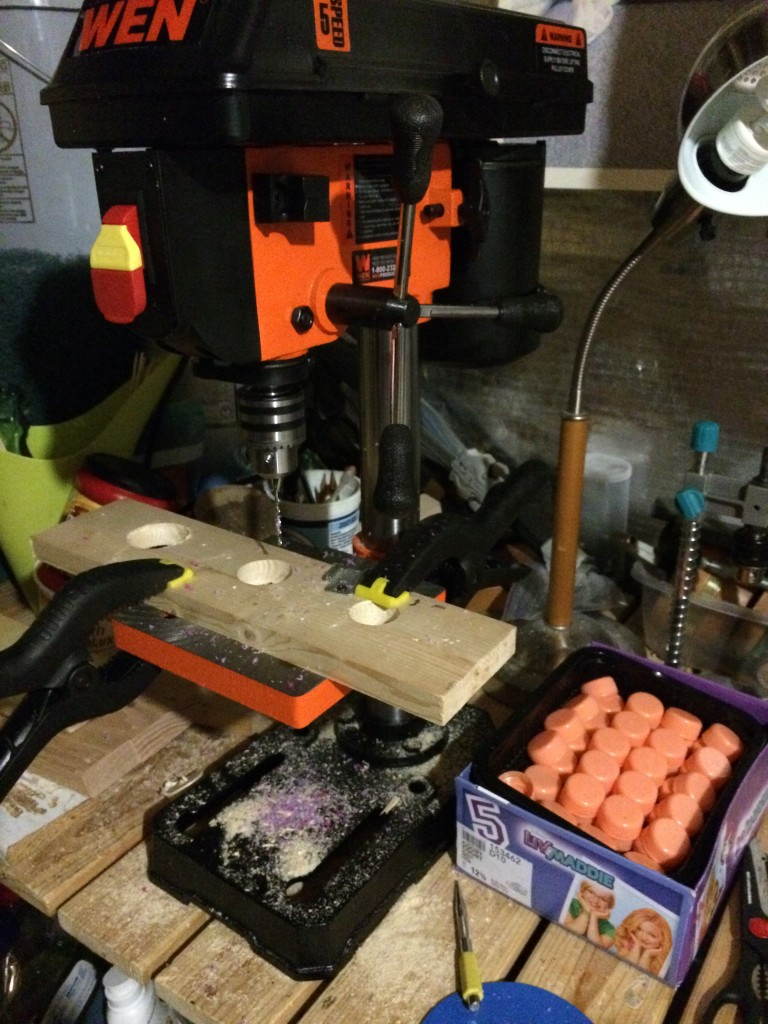 Drill press with safety set-up for drilling plastic caps