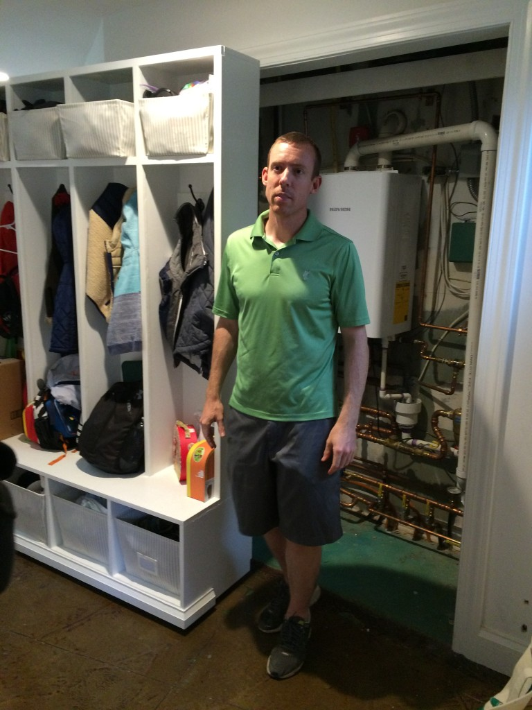 Homeowner on Solar Home Tour by roll-out mudroom structure