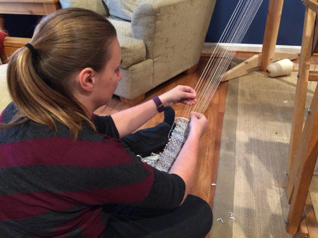 Hand weaving plastic bags