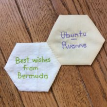 Two hexagon quilt blocks with words written on them
