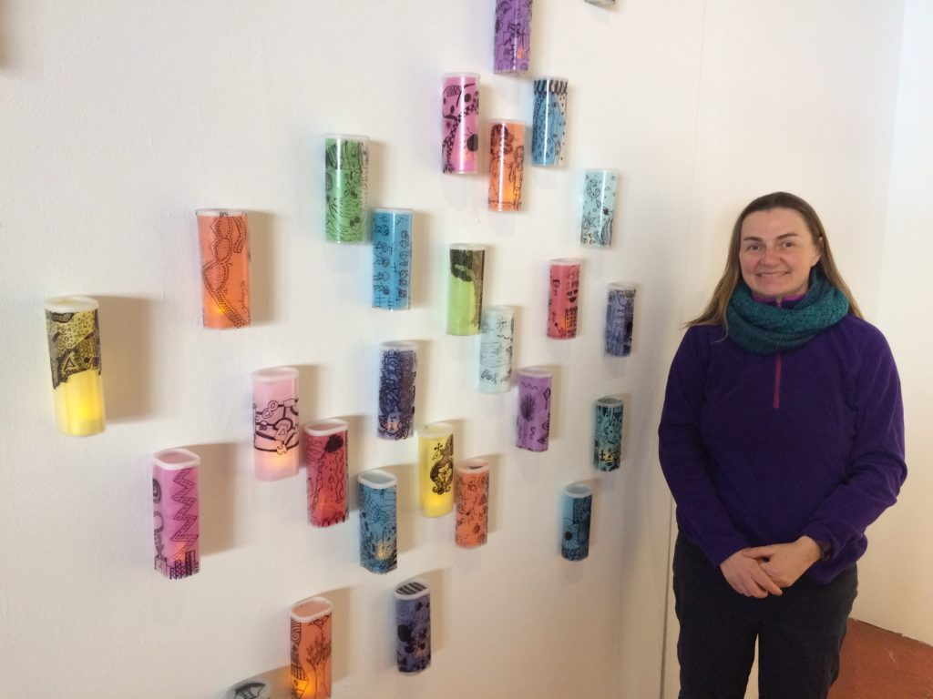 "Woman standing beside ""Lanterns"" from recycled Crystal Light Containers and Tissue Paper Inspired by Paul Klee - designed by Trashmagination"