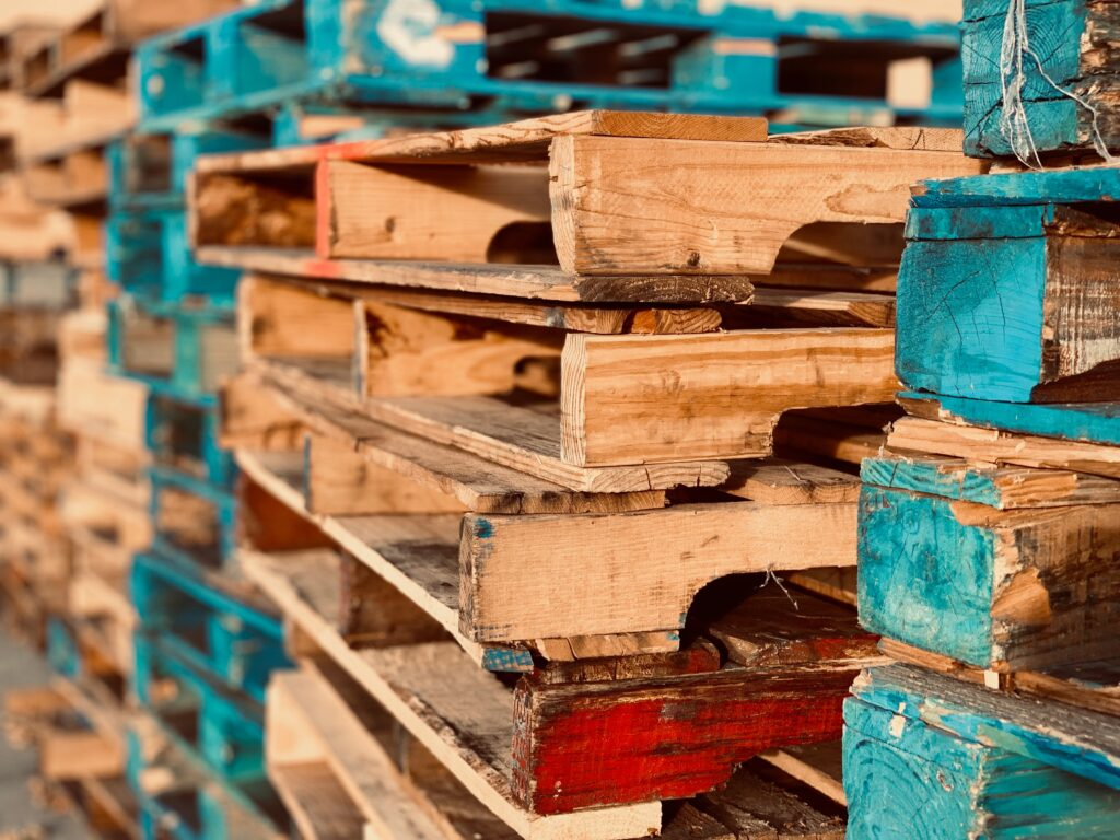 Pile of wood pallets - brown and aqua - by Brent Keane, Pexels
