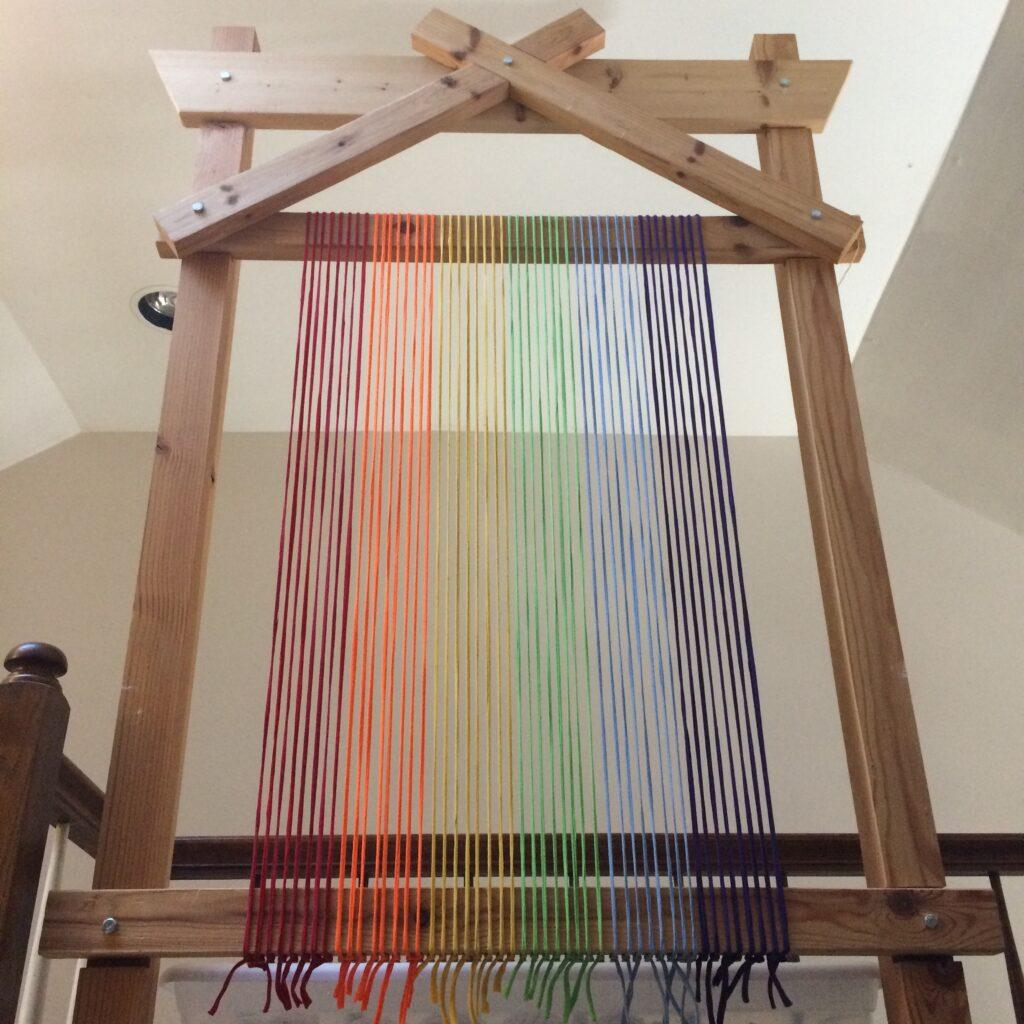 Rainbow warp on Trashmagination's tapestry loom