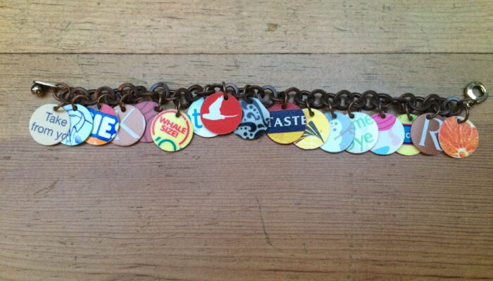 Bracelet made from colorful circles of plastic cut from laundry soap jugs and gift cards