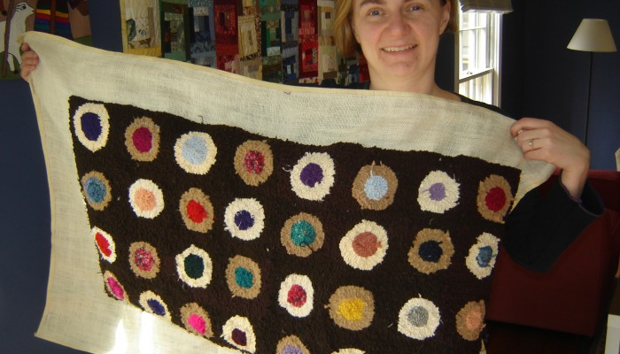 Carla Brown with hooked rug she made
