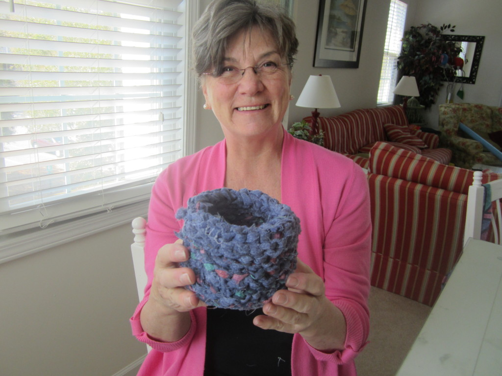 Mom holding up a basket she made from recycled sheets