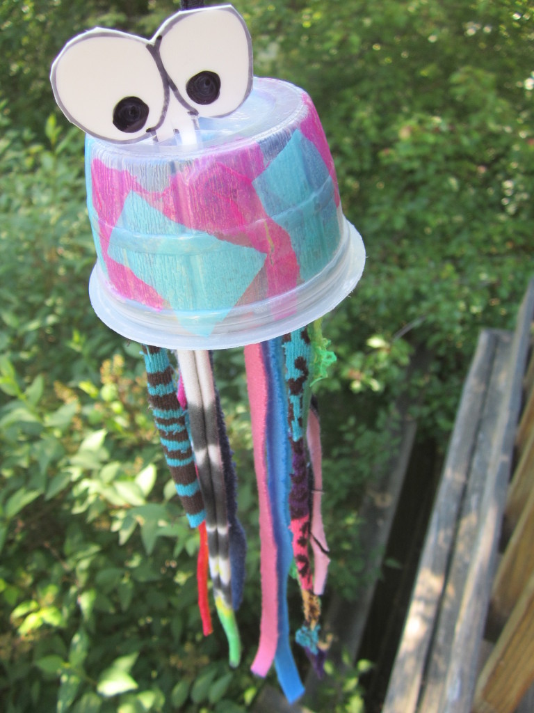 Jellyfish craft from recycled applesauce snack container and recycled socks