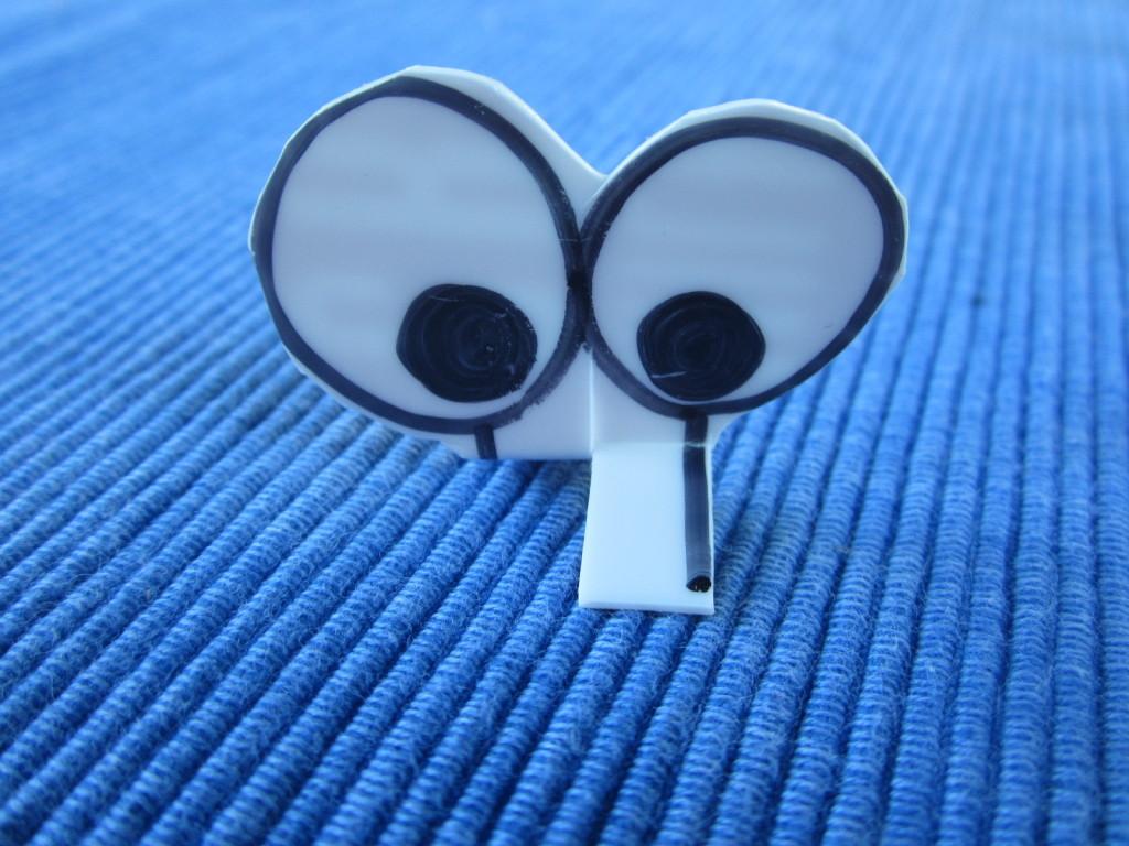 Eyeballs made from plastic yogurt lid