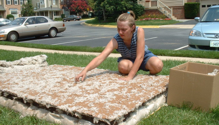 Picking off the yucky fluffy stuff from the coir layer in the mattress