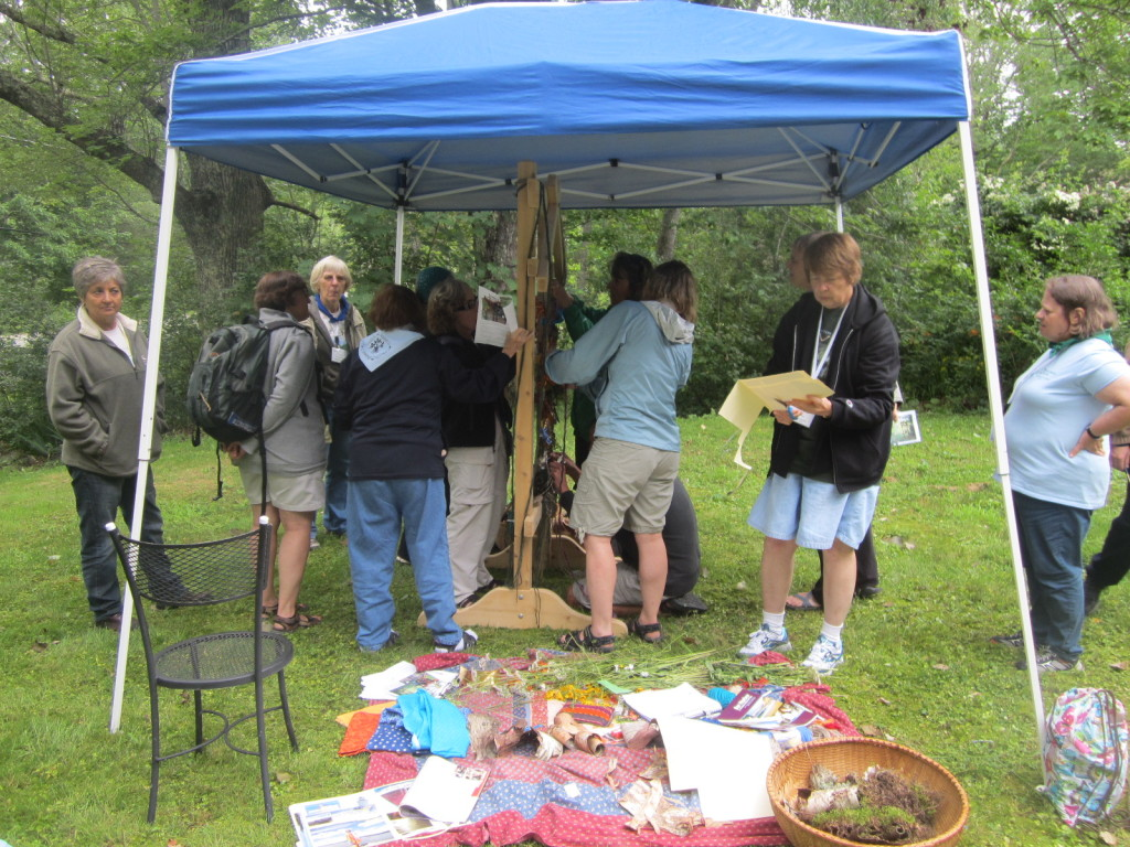 Summiteers adding items to the Weaving a Life loom