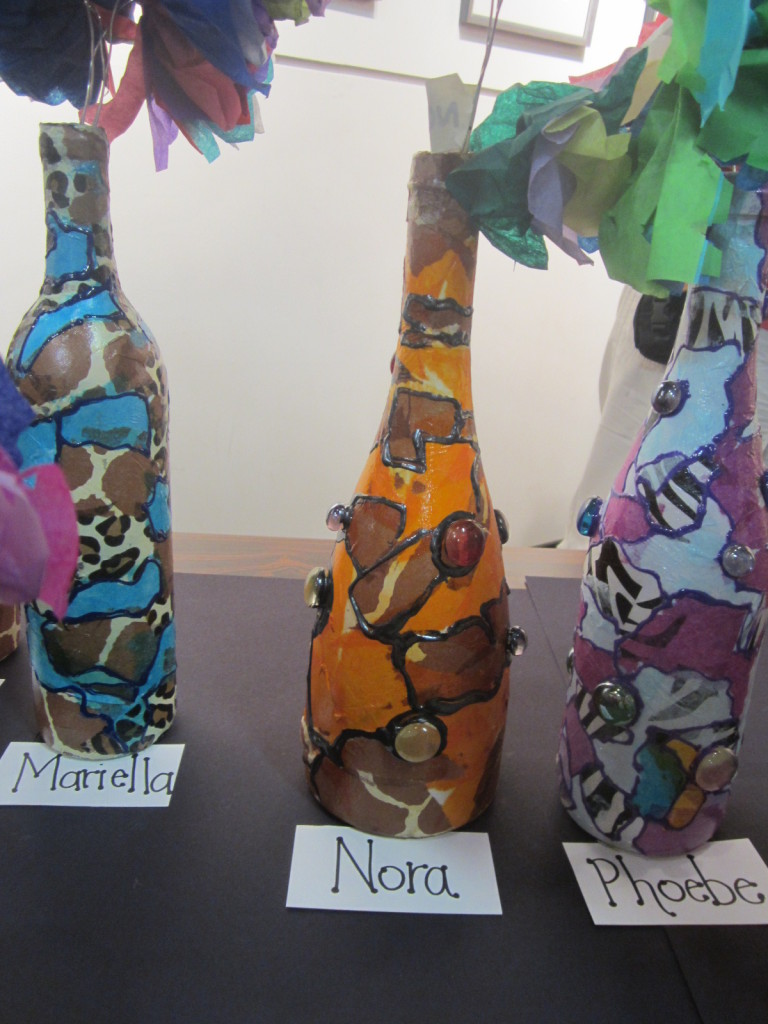 Bottles decorated with tissue paper
