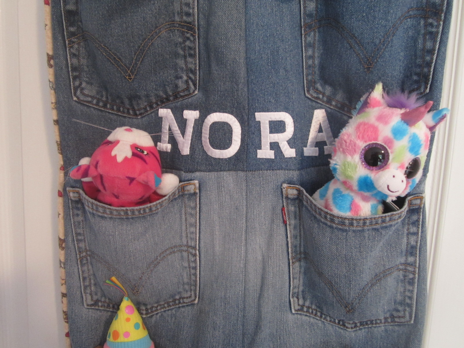 Toy organizer from recycled jeans
