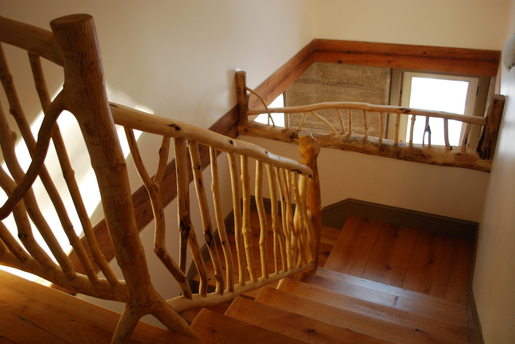 Stair Railings in Rammed Earth House - Photo by Susan Turner