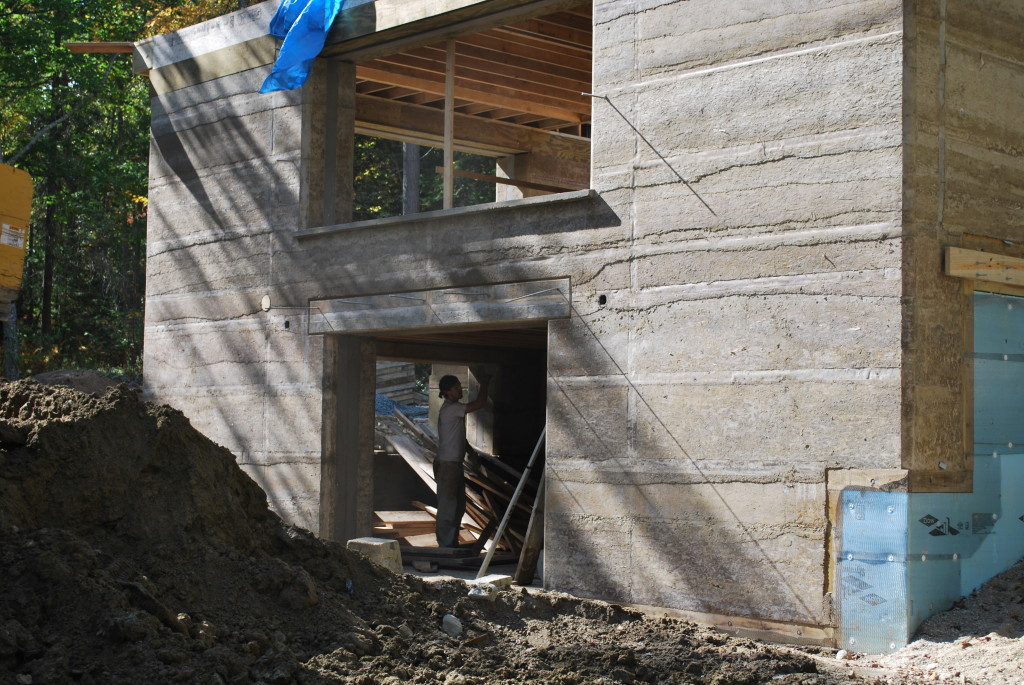Rammed Earth House during Construction, showing Wall Layers, Photo by Susan Turner